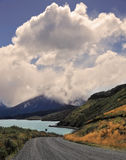 Whimsically curved gravel road. National Park in Chilean Patagonia - Torres del Paine. Gravel road bends along the shores of Lake Pehoe Stock Image