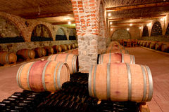 Whine barrels in a cellar Stock Images