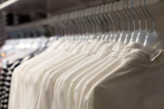 Whine Fashionable clothes on hangers Stock Image