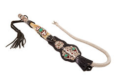 Whip. Kazakh leather whip on the white background Stock Photos
