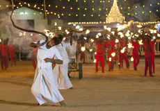 Whip Crackers enter the procession ground at the Kataragama Festival in Sri Lanka. Royalty Free Stock Photos