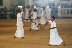 Whip Crackers enter the procession ground at the Kataragama Festival in Sri Lanka. Royalty Free Stock Photography