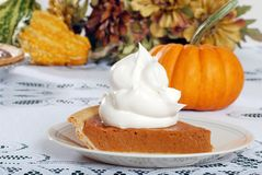Whip cream loaded on pumpkin pie Royalty Free Stock Image