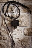 Whip and handcuffs on the wall. Whip and handcuffs on the brick wall royalty free stock photos
