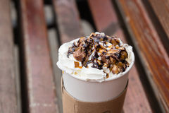 Whiped cream on coffe to go Royalty Free Stock Photos