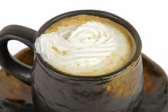 Whipped coffee cup. Close-up image of a whipped coffee cup over white background Royalty Free Stock Photo