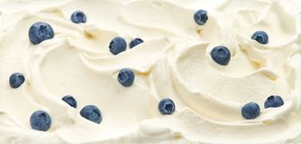 Whipped cream with blueberries royalty free stock photography
