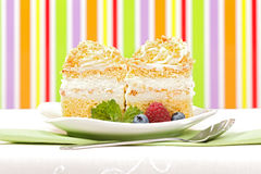 Whipped cream cake garnished with berries Stock Images