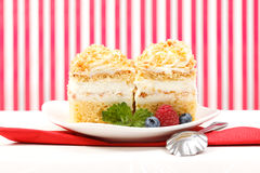 Whipped cream cake garnished with berries Royalty Free Stock Images