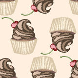 Whipped cream and cherry on beige background Royalty Free Stock Photo