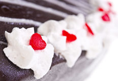 Whipped cream on chocolate cake. Close-up Royalty Free Stock Image