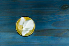 Whipped cream on cup of coffee Royalty Free Stock Images