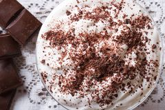 Whipped cream with dark chocolate close-up. top view Stock Photography