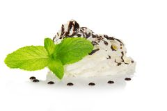 Whipped cream is decorated by spearmint and the Royalty Free Stock Photography