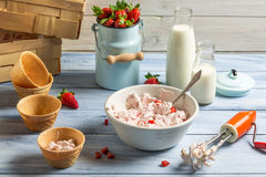 Whipped cream and fresh strawberries as ingredients for ice crea Stock Photos