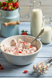 Whipped cream and fresh strawberries. As ingredients for ice cream on old wooden table royalty free stock image