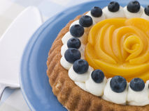 Whipped Cream Peach and Blueberry Sponge Flan stock image