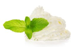 Whipped cream and spearmint leaves Stock Photography