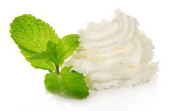 Whipped cream and spearmint leaves Stock Photo
