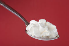 Whipped cream on spoon Royalty Free Stock Image