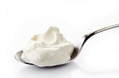 Whipped cream in a spoon Royalty Free Stock Photo