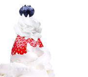 Whipped cream with tasty blue berrie and strawberry Stock Image