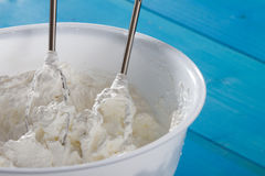 Whipped Cream and whisk in Plastic Bowl Royalty Free Stock Photos