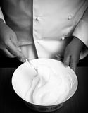Whipped egg whites for pastry in a white ceramic bowl. Toned Stock Photography
