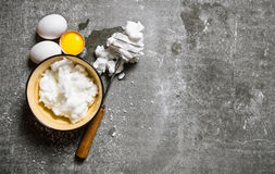 Whipped eggs in a bowl with a whisk. Stock Photos