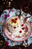 Whipped mascarpone cream cheese with white chocolate, fresh raspberry and pistachios in a jar royalty free stock photography