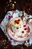 Whipped mascarpone cream cheese with white chocolate, fresh raspberry and pistachios in a jar. Selective focus royalty free stock image