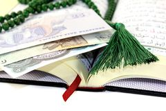 Whipped Quran with Egyptian currency Stock Image