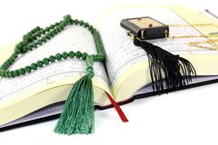 Whipped Quran with green rosary Stock Photos