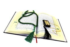 Whipped Quran with rosary Royalty Free Stock Photos
