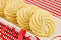 Whipped shortbread pinwheels. Delicate whipped shortbread pinwheels in festive setting Royalty Free Stock Photography