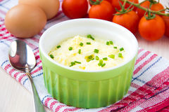 Whipped steam eggs in a cup with green onions for breakfast Royalty Free Stock Photos