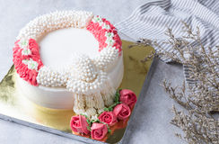 Whipping cream cake decoration as a jasmine garland Royalty Free Stock Photography