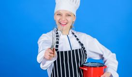 Whipping like pro. Girl in apron whipping eggs or cream. Start slowly whisking whipping or beating cream. Use hand whisk stock image