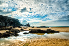 Whipsiderry beach. Sun settting at Whipsiderry beach, Watergate Bay, Cornwall, United Kingdom Stock Photos