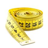 Whirled yellow tape measure Stock Photography