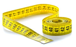 Whirled yellow tape measure Stock Images