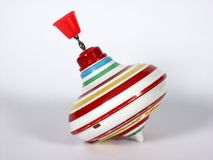 Whirligig. Old plastic toy whirligig with red handle Royalty Free Stock Photo