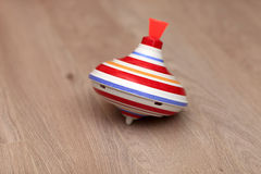 Whirligig. The striped whirligig is lying on a parquet Royalty Free Stock Photography