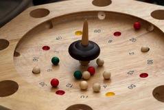 Whirligig game. Whirligig spinning around wooden balls Stock Photography