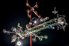 A whirligig spins at night. WILSON, NC - FEBRUARY 2, 2017: A whirligig spins at night in the Vollis Simpson Whirligig Park in Wilson, NC. The whirligigs are part Royalty Free Stock Photo