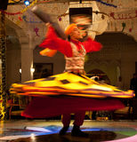 Whirling Dervish. Es due to their famous practice of whirling as a form of dhikr (remembrance of God). Dervish is a common term for an initiate of the Sufi path Stock Photo
