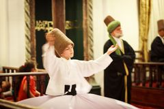 Whirling dervish boy royalty free stock photography