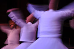 Whirling Dervish Dancers. Dancers of the Mevlevi Sufi Order in Turkey, also known as the Whirling Dervishes perform in the formal Sama religious ceremony Royalty Free Stock Photos