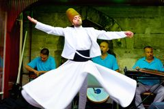 Whirling dervish on stage. Sufi whirling dervish (Semazen) dances at Sultanahmet during holy month of Ramadan on July 25, 2012 in Istanbul. Semazen conveys God's Stock Images