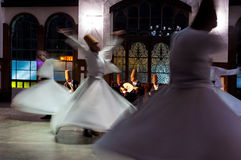 Whirling dervishes. And musicians perform to visitors in the event hall of the Sirkeci Train Station, the old terminus of the Orient Express on October 21, 2005 Stock Photos